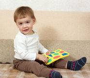Little girl with plastic block Stock Photo