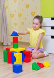 Little girl with plastic cubes Stock Photos