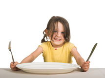 Little girl with plate Royalty Free Stock Photography