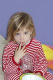 Little girl with plate and water bottle Stock Photo