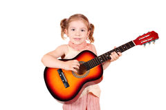 Little girl play acoustic guitar Royalty Free Stock Images