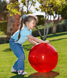 Little girl play with  ball in the park Royalty Free Stock Photo