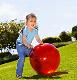 Little girl play with  ball in the park Stock Images