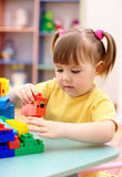 Little girl play with building bricks in preschool Stock Photography