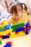 Little girl play with building bricks in preschool. Cute little girl play with building bricks in preschool stock photos