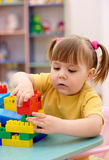 Little girl play with building bricks in preschool. Cute little girl play with building bricks in preschool royalty free stock photos