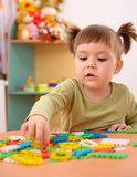 Little girl play with building bricks in preschool Stock Photo