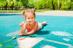 Little girl play with chalk Royalty Free Stock Image