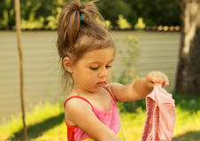 Little girl play and changes clothes Royalty Free Stock Images