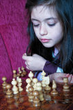 Little girl play chess game Stock Photography