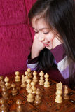 Little girl play chess game Royalty Free Stock Image