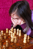 Little girl play chess game Royalty Free Stock Images