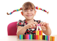 Little girl play with colorful plasticine Royalty Free Stock Photography
