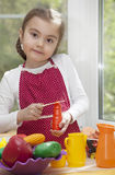 Little girl play cooking Royalty Free Stock Images