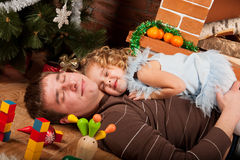Little girl play with dad  near Christmas tree Royalty Free Stock Photos