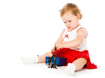 Little girl play on a floor. Isolated on white background Royalty Free Stock Photos