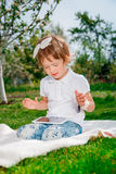 Little girl play a game on tablet. Stock Photos