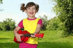 Little girl play guitar and sing. Happy little girl play guitar and sing Royalty Free Stock Image