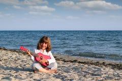 Little girl play guitar Stock Image