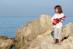 Little girl play guitar Stock Photos