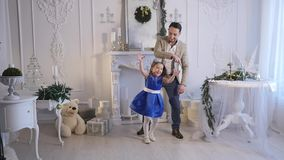 Little girl play with her dad . Christmas theme stock video