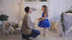 Little girl play with her dad . Christmas theme stock footage