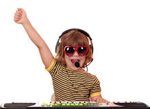 Little girl play keyboard and sing Stock Photo