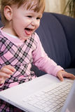 Little girl play with laptop Royalty Free Stock Photos