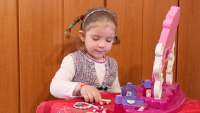 Little girl play with make up stock footage