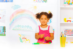 Little girl play with modeling clay in classroom Stock Photos