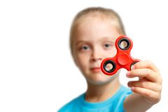 Little girl play with modern finger spinner. New spinning device.Play balance game with popular rotating gadget on bearings stock images