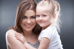 Little girl play with mother Royalty Free Stock Image