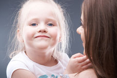 Little girl play with mother Stock Image