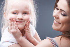Little girl play with mother Stock Images