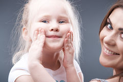 Little girl play with mother Royalty Free Stock Photos