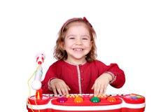 Little girl play music Stock Photos