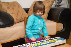 Little girl play music on keyboard Royalty Free Stock Photography