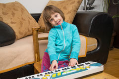 Little girl play music on keyboard Royalty Free Stock Images