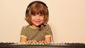 Little girl play music on keyboard Stock Photography