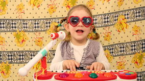 Little girl play music Royalty Free Stock Photo
