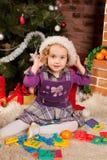 Little girl play near Christmas tree Stock Image