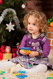Little girl play near Christmas tree Stock Images