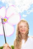 Little girl play outside with a wind flower Royalty Free Stock Photography
