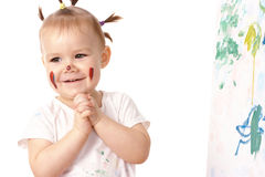 Little girl play with paints Royalty Free Stock Images