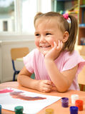 Little girl is play with paints Royalty Free Stock Photo
