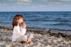 Little girl play pan pipe Royalty Free Stock Photos