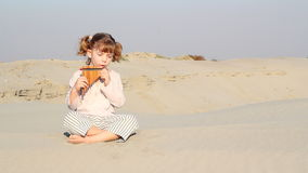 Little girl play panpipe stock video footage