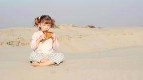 Little girl play panpipe Stock Image