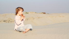 Little girl play panpipe stock video