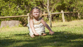 Little girl play in the park. Little girl plays in the park by herself Stock Images